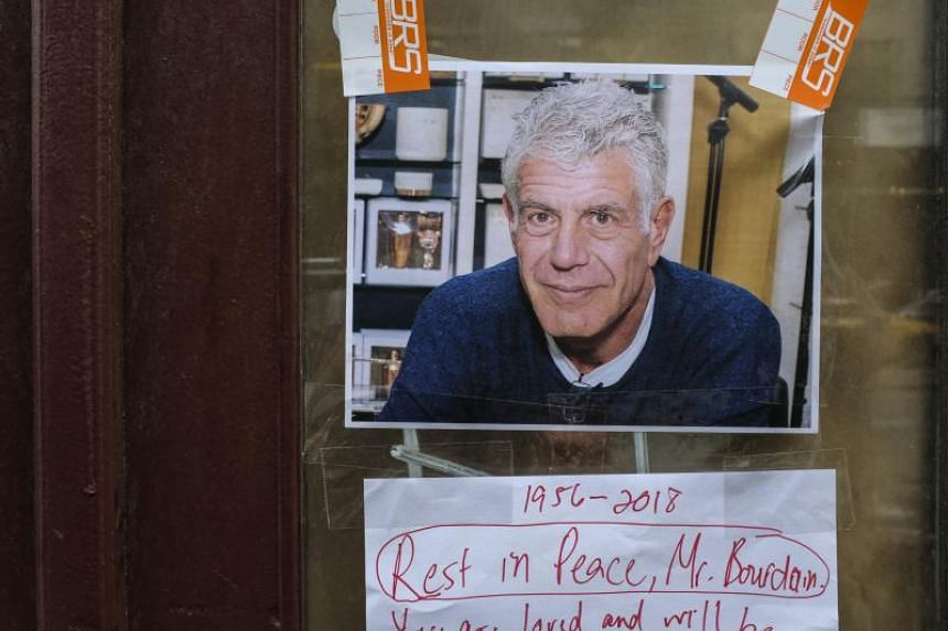 Notes, photographs and flowers are left in memory of Anthony Bourdain at the closed location of Brasserie Les Halles, where Bourdain used to work as the executive chef in New York City, on June 8, 2018.