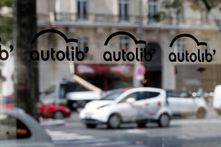 An electric Bluecar is reflected on an Autolib' car-sharing enrollment kiosk in Paris, France, on June 21, 2018.