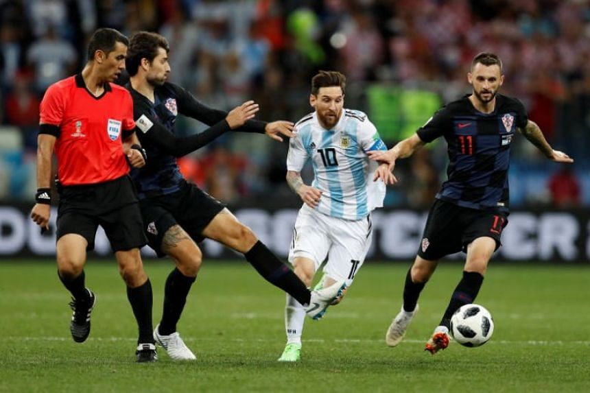 Croatia's Vedran Corluka and Marcelo Brozovic in action with Argentina's Lionel Messi at the Nizhny Novgorod Stadium, Nizhny Novgorod, Russia, on June 21, 2018.