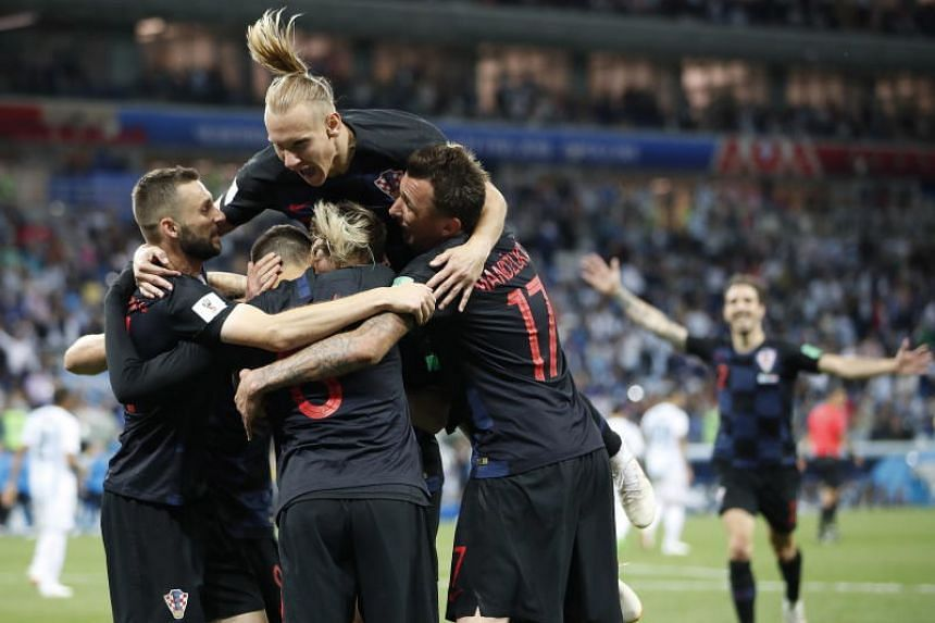 Croatian players celebrate their third goal during the Fifa World Cup 2018 group D preliminary round soccer match between Argentina and Croatia in Nizhny Novgorod, Russia, on June 21, 2018.