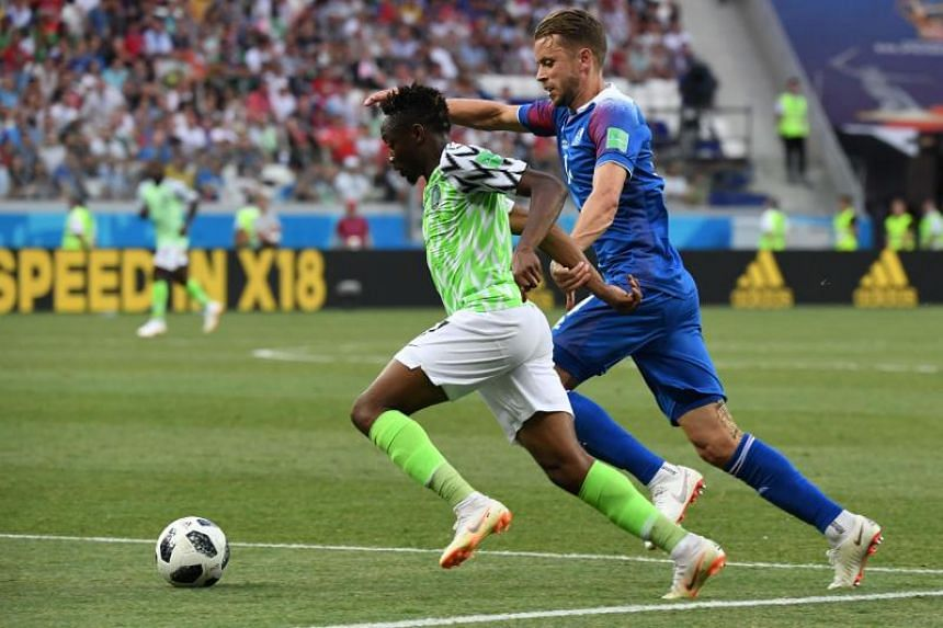 Nigeria's forward Ahmed Musa (left) vies with Iceland's defender Kari Arnason during the Russia 2018 World Cup Group D football match between Nigeria and Iceland at the Volgograd Arena in Volgograd on June 22, 2018.