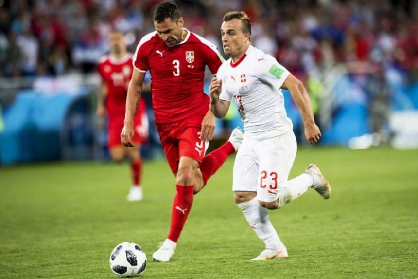 Switzerland's midfielder Xherdan Shaqiri (right) on his way to scoring the winning goal against Serbia's defender Dusko Tosic during the Fifa World Cup 2018 group E preliminary round soccer match between Switzerland and Serbia in Kaliningrad, Russia,