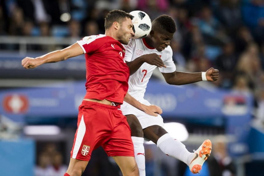 Serbia's defender Dusko Tosic (left) fights for the ball with Switzerland's forward Breel Embolo during the Fifa World Cup 2018 group E preliminary round soccer match between Switzerland and Serbia in Kaliningrad, Russia, on June 22, 2018.