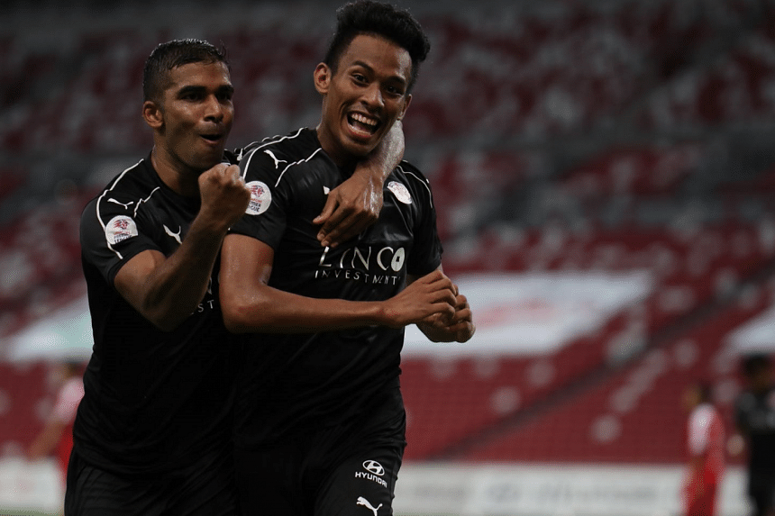 Home United's M. Anumanthan celebrating with Iqram Rifqi after the latter's 90th-minute equaliser in the Singapore Premier League match against Home United at the National Stadium on June 23, 2018.