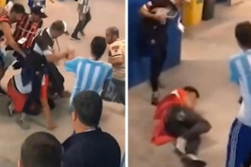 The video shows men in Argentina and Croatia team colours kicking and punching each other as onlookers try to break up the fight.
