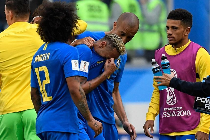 Brazil's forward Neymar (centre) is consoled by teammates at the end of the Russia 2018 World Cup Group E football match between Brazil and Costa Rica, on June 22, 2018.