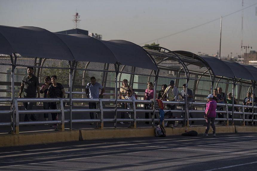 Pedestrians on the Paso del Norte International Bridge, which crosses between El Paso, Texas, and Ciudad Juárez, Mexico, on June 22, 2018.