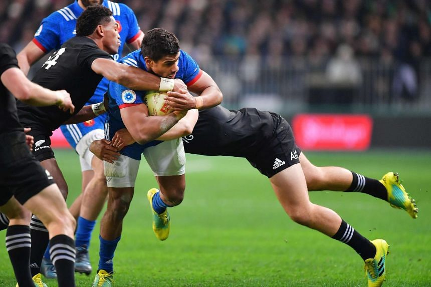 France's Wesley Fofana is tackled by New Zealand's Jack Goodhue (right) and Waisake Naholo during the third and final rugby Test match at Forsyth Barr Stadium in Dunedin on June 23, 2018. The All Blacks won 49-14.