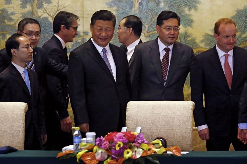 Chinese President Xi Jinping (centre) with members of a global chief executive committee before their meeting at the Diaoyutai State Guesthouse in Beijing on Thursday. Mr Xi said foreign capital had played an important role in China's reform.