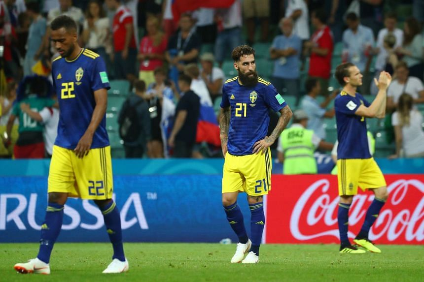 Sweden's Jimmy Durmaz (#21) walking on the pitch following his team's World Cup loss to Germany on June 23, 2018.
