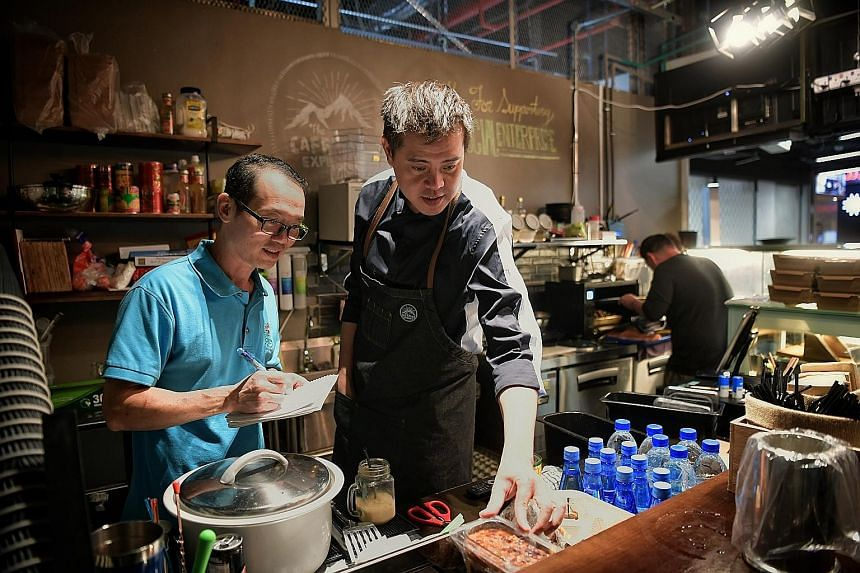 Former prison officer Hilary Lo (left) is now The Caffeine Experience's operations manager, while former drug dealer Matthew Poh handles the front end of the business as the cafe's administrator.