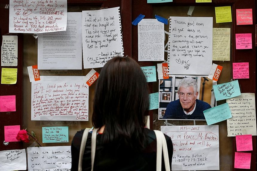 Tributes to Mr Anthony Bourdain outside Brasserie Les Halles in New York on June 11. The chef and television personality was found dead on June 8 in a hotel bathroom in Kaysersberg, a small village in the Alsace region of France, where he had been fi