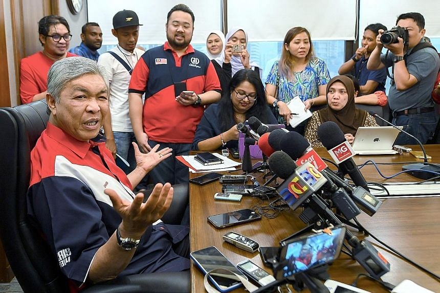 Umno's acting president Ahmad Zahid Hamidi at a press conference in Putra World Trade Centre. He has agreed to a televised debate on Friday against his two main rivals for the post of party president.