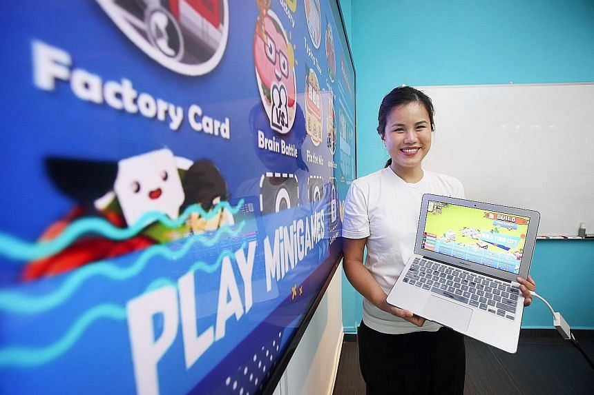 Ms Janine Teo with the learning game her organisation developed to give children access to good-quality education. The scores in the game can be used to measure literacy and numeracy skills.