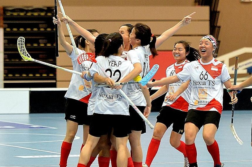 The Singapore team celebrating after beating Thailand 4-1 in the final of the Women's Asia-Oceania Floorball Confederation Cup.