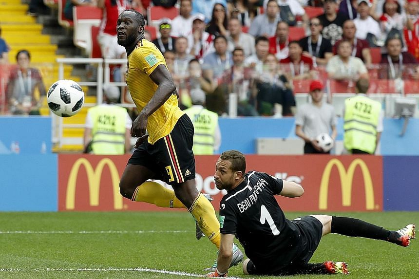 Romelu Lukaku scoring his second goal past Tunisia goalkeeper Farouk Ben Mustapha to give Belgium a 3-1 lead in their World Cup 2018 Group G match in Moscow yesterday.