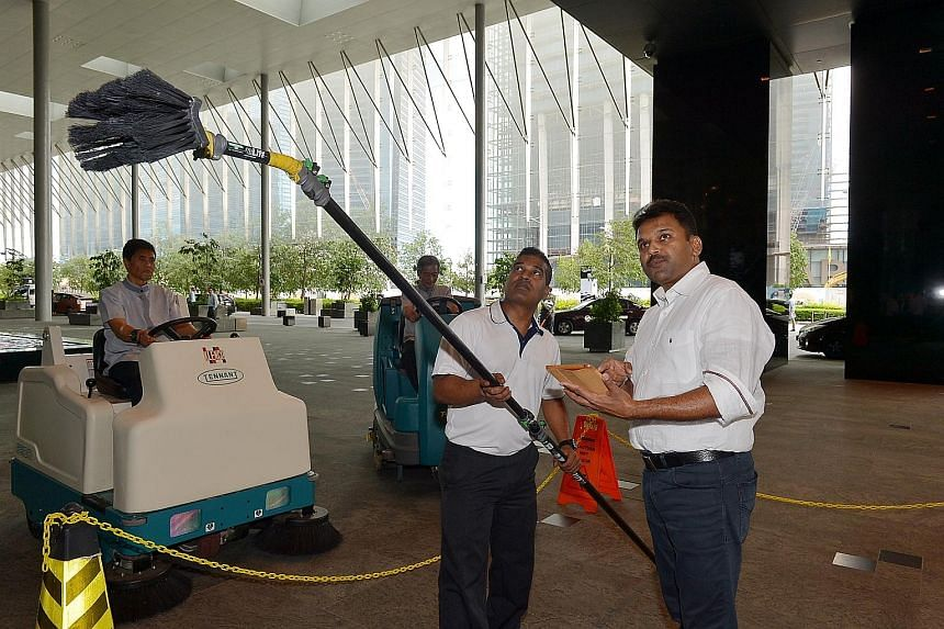 Cleaning Express chief executive Abdul Aziz Yusof (left photo, right) says while he tries to maintain his workers' salaries at a higher level, it can be tough when competitors bid for contracts at lower prices. Prosegur Singapore director Robert Wien