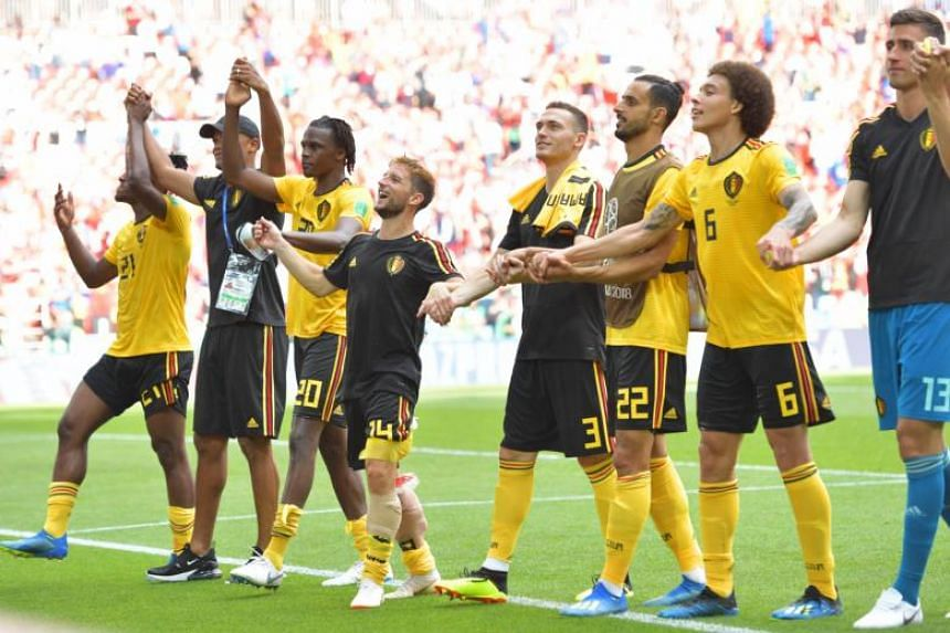 Players of Belgium celebrate with fans after the Russia 2018 World Cup Group G football match against Tunisia in Moscow, Russia, on June 23, 2018. Belgium won 5-2.