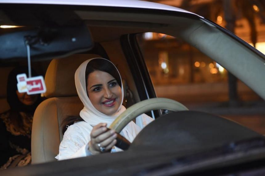 Saudi Samar Al-Moqren drives her car through the streets of the Saudi capital Riyadh for the first time just after midnight, on June 24, 2018.