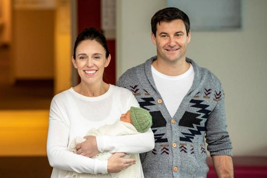 New Zealand Prime Minister Jacinda Ardern (left) holds her newborn baby daughter next to her partner Clarke Gayford in Auckland, New Zealand, on June 24, 2018.