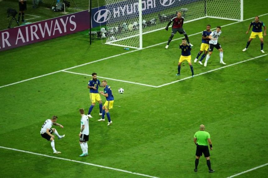 Germany's Toni Kroos scores their second goal during the Russia 2018 World Cup Group F football match against Sweden at Fisht Stadium in Sochi, Russia, on June 23, 2018.