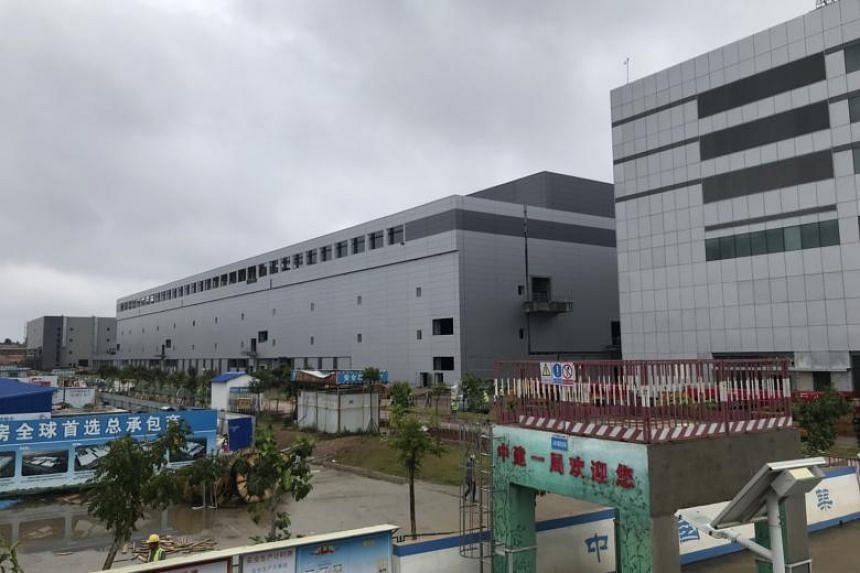 A chip factory with some 100,000 square feet of office space in a region formerly known for manufacturing shoes, being built by Fujian Jinhua, a new semiconductor maker, in Jinjiang, Fujian Province, China, in June, 2018.