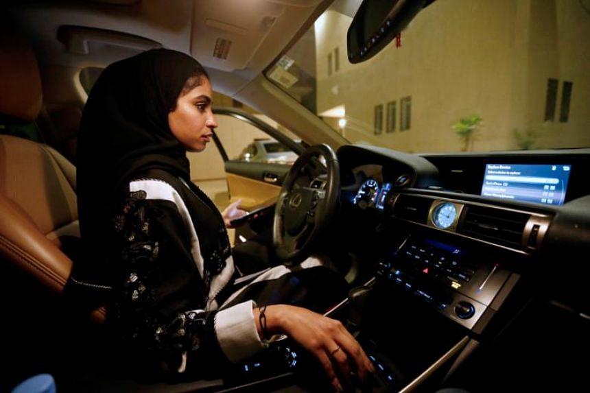 Majdooleen, who is among the first Saudi women allowed to drive in Saudi Arabia, gets ready before she starts to drive her car in her neighbourhood in Riyadh, Saudi Arabia, on June 23, 2018.