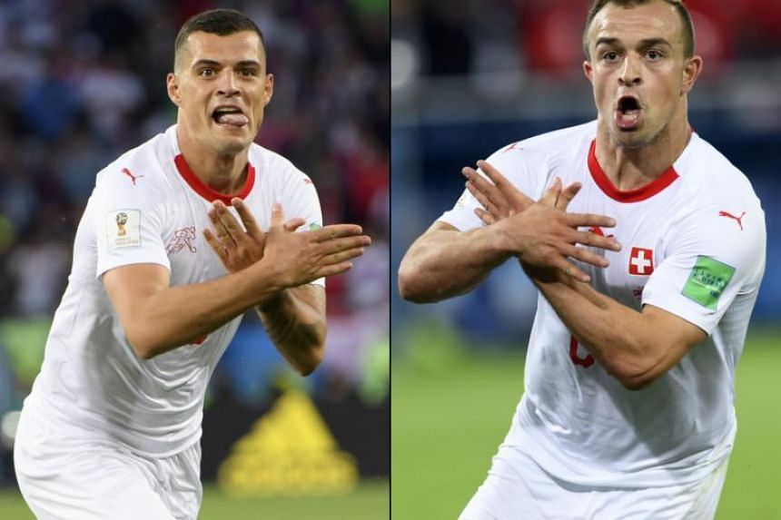 Switzerland's midfielder Granit Xhaka (left), and midfielder Xherdan Shaqiri, both making the eagle emblem of the Kosovo during the Russia World Cup 2018 group E football match against Serbia at the Arena Baltika Stadium, in Kaliningrad, Russia, on J