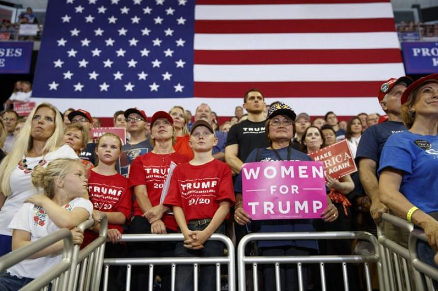 Supporters cheer President Donald Trump during a campaign rally in Duluth, Minnesota, on June 20, 2018.