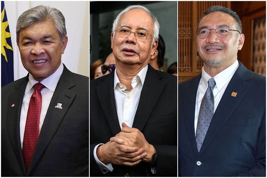 Among the division leaders who won uncontested were Datuk Seri Najib Tun Razak (centre), Datuk Seri Dr Ahmad Zahid Hamidi (left) and Datuk Seri Hishammuddin Hussein.