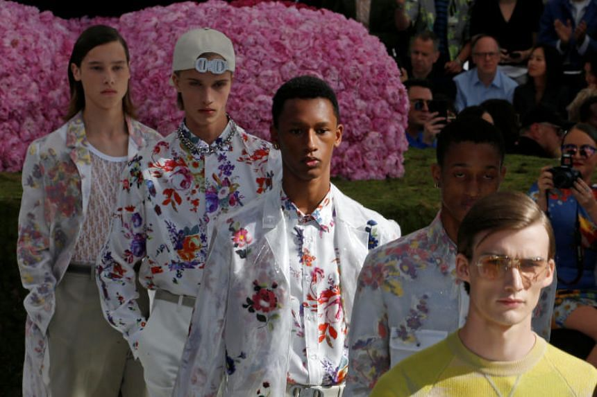 Models present creations by designer Kim Jones for Dior Homme collection as part of their Spring/Summer 2019 collection show during Men's Fashion Week in Paris, France, on June 23, 2018.