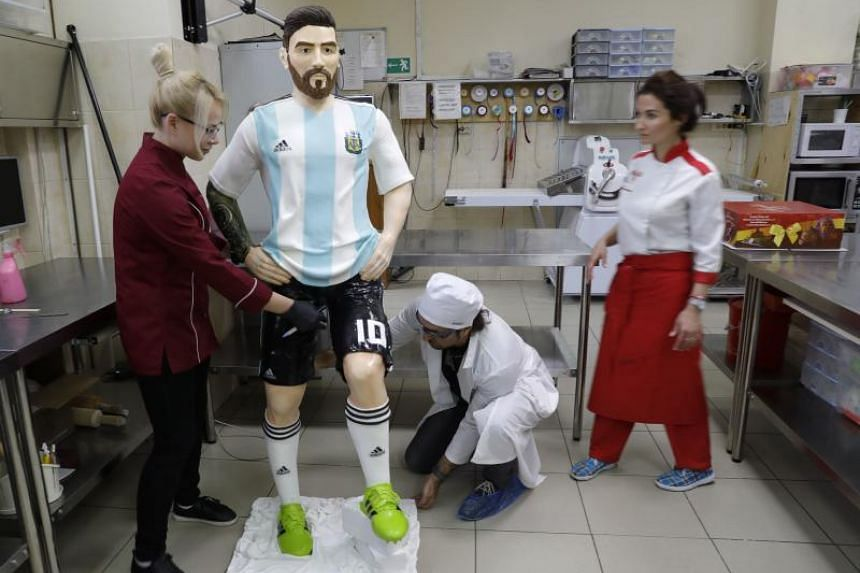 Bakers of Altufyevo Confectionery prepare a life-size chocolate sculpture of Argentine soccer player Lionel Messi to top a cake for the celebration of his upcoming birthday in Moscow, a host city for the World Cup, Russia, on June 23, 2018.