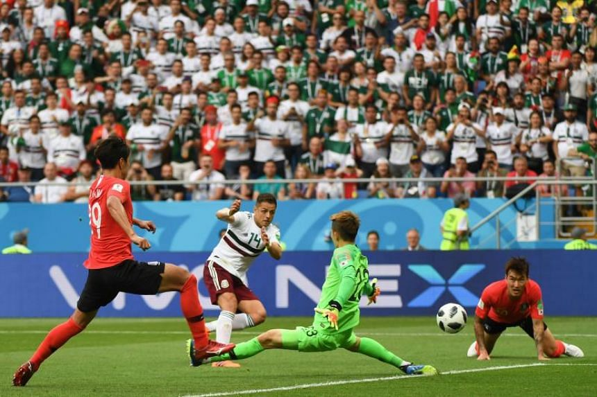 Mexico's forward Javier Hernandez (second from left) scores their second goal past South Korea's goalkeeper Cho Hyun-woo (second from right) during the Russia 2018 World Cup Group F football match between South Korea and Mexico at the Rostov Arena in