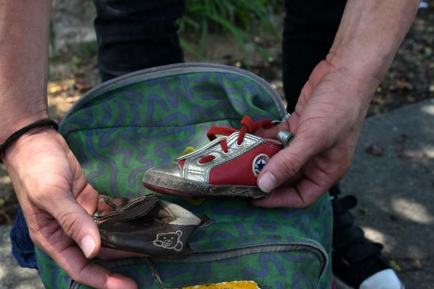 Honduran immigrant Ever Sierra, 28, shows two little shoes that belong to his baby after being deported from the US and arriving in San Pedro Sula, 200 kilometres north of Tegucigalpa on June 22, 2018.