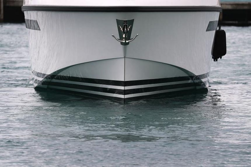 The bow of a boat is seen in a marina on June 6, 2018, in Miami Beach, Florida.