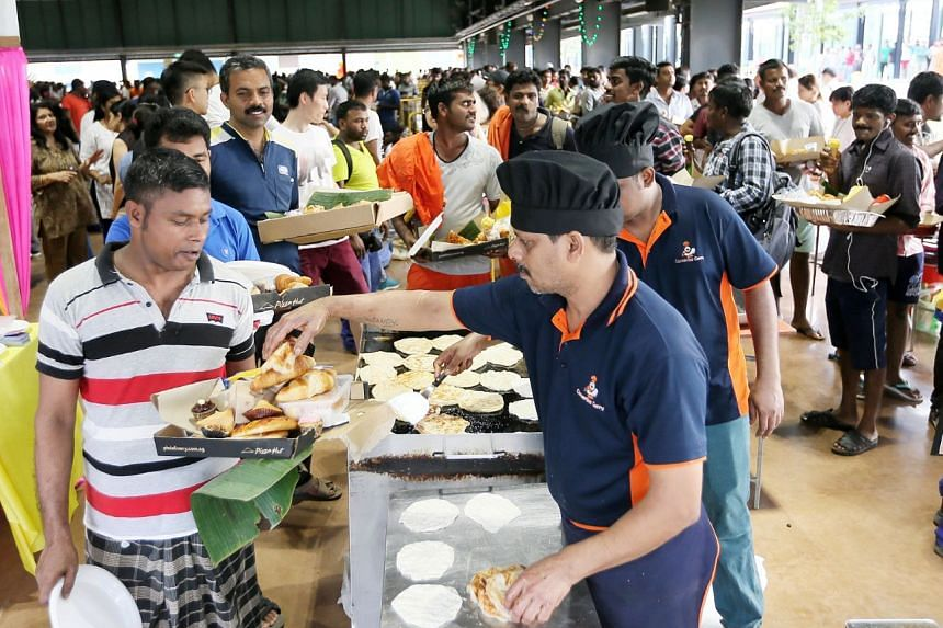 Migrant workers queueing to collecting their food.