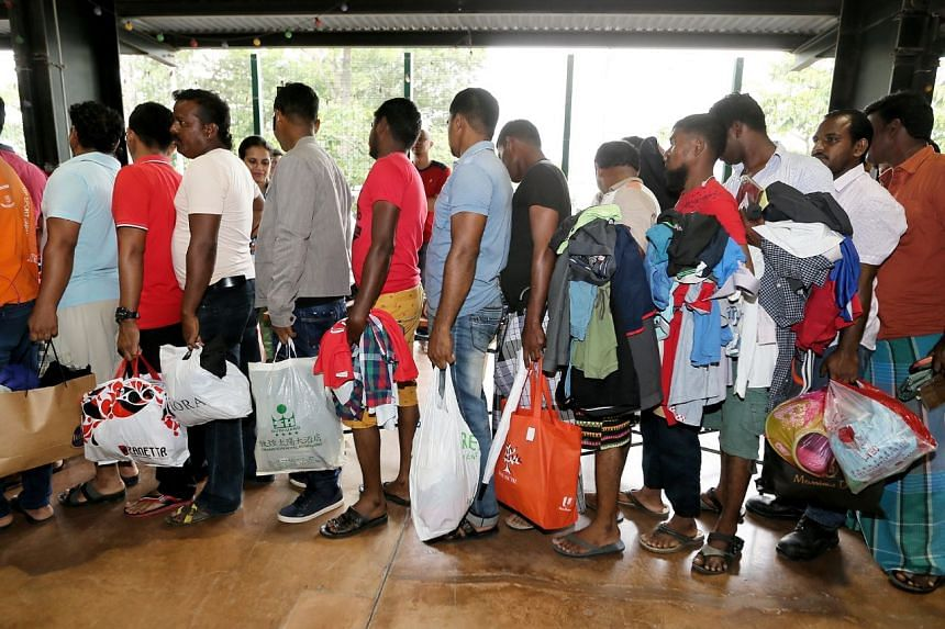 Workers queueing up to select second-hand clothing at the ItsRainingRaincoats event.