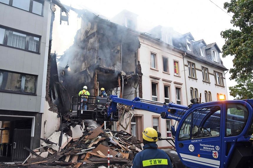 THW technical relief service workers inspecting the debris of a house that exploded, in Wuppertal, Germany, on June 24, 2018.