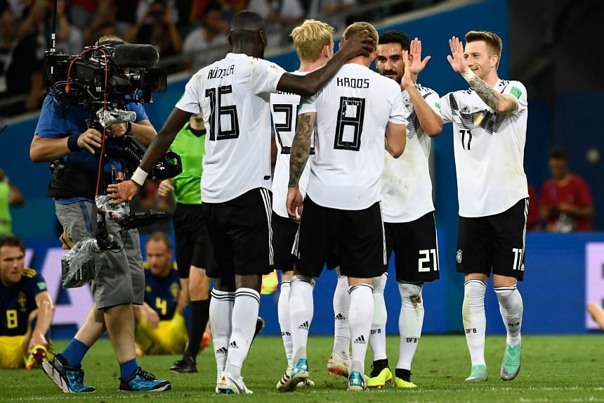 German players celebrating after they defeated Sweden during their World Cup match on June 23, 2018.