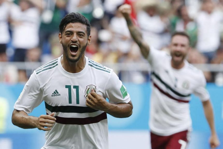 Carlos Vela of Mexico celebrates after converting a penalty during the FIFA World Cup 2018 group F preliminary round soccer match between South Korea and Mexico on June 23, 2018.