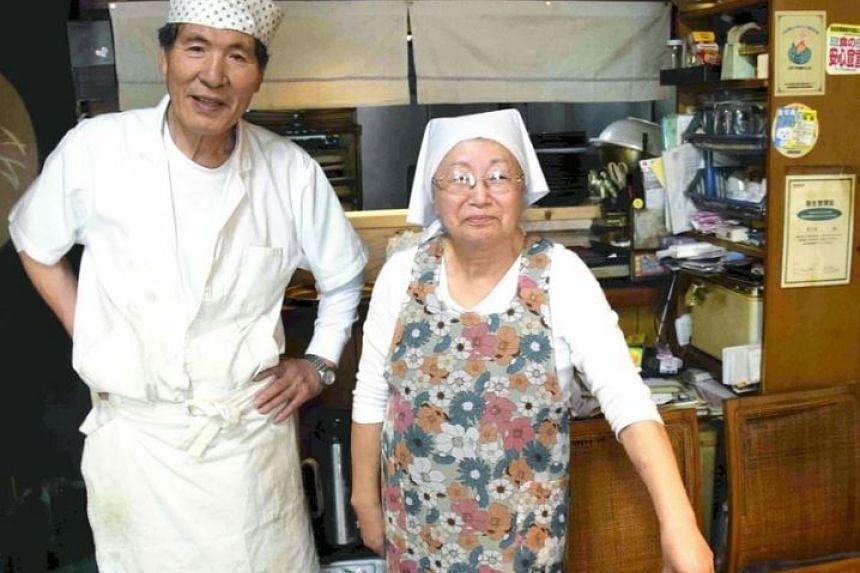 Susumu Kikuta (left) and his wife Setsuko pose for a photo at the Kikunoya restaurant in Takasaki, Gunma Prefecture.