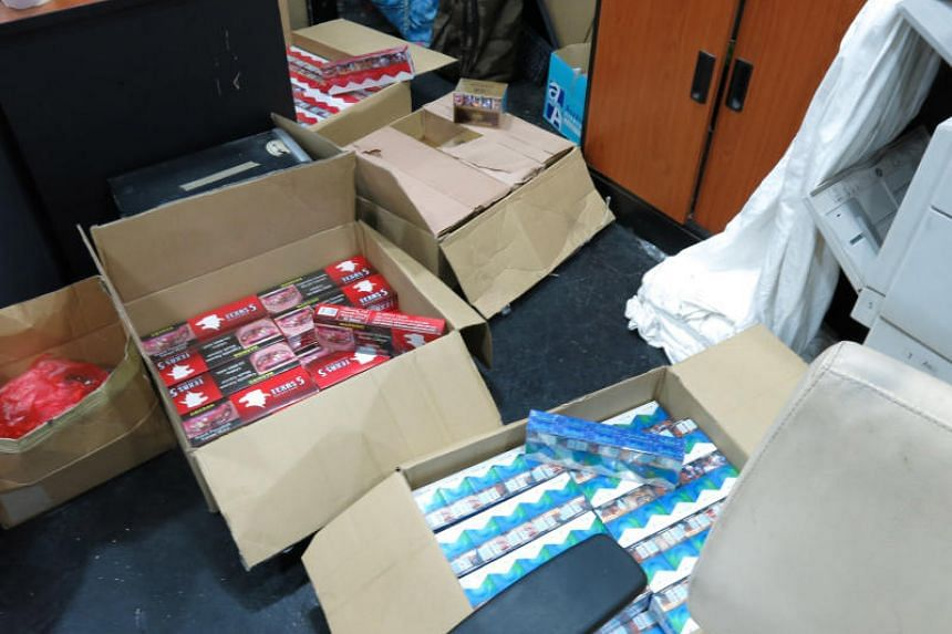 Contraband cigarettes seized by Singapore Customs on April 24, 2018. The agency said more people have been caught buying or possessing such cigarettes in the past year.
