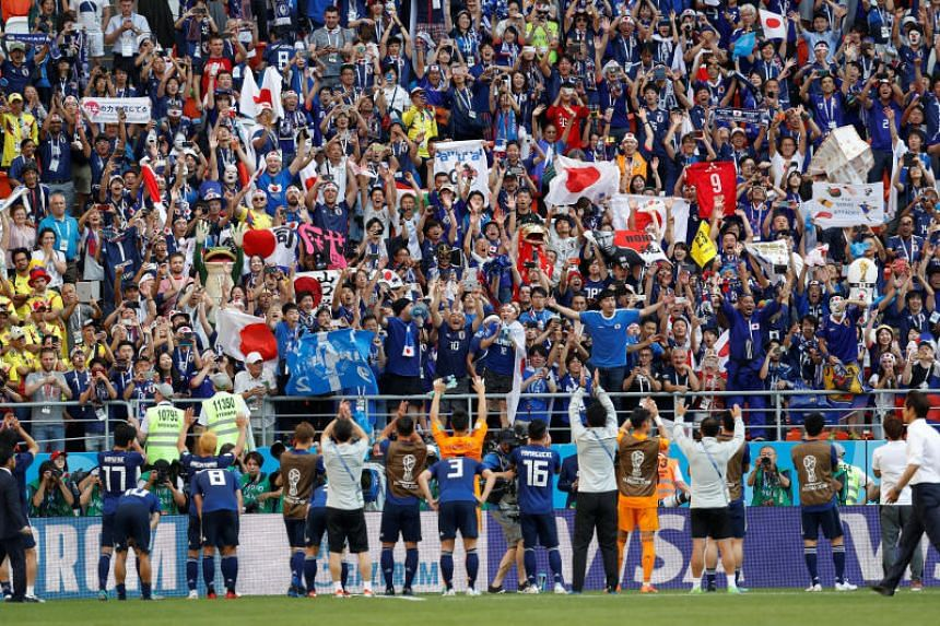 Japanese fans cheering and celebrating after their team defeated Colombia during their World Cup match on June 19, 2018.