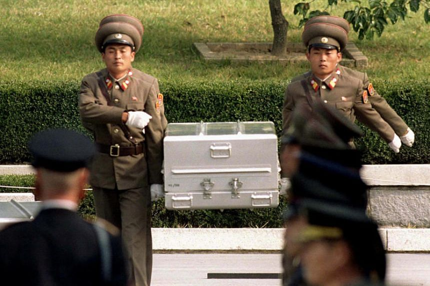 North Korean soldiers carrying what is believed to be the remains of a US soldier to the South Korean border on Oct 9, 1998. The US is sending 215 caskets to North Korea to bring back the remains of US soldiers, it was reported on June 23, 2018.