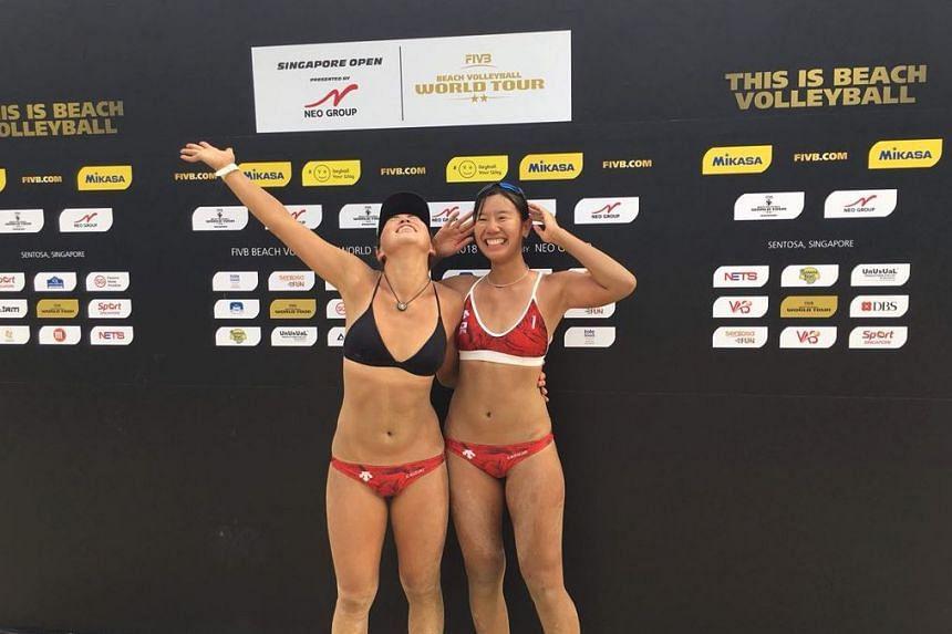 Chiyo Suzuki (left) and Reika Murakami celebrating after winning the FIVB World Tour title in Singapore on June 24, 2018.