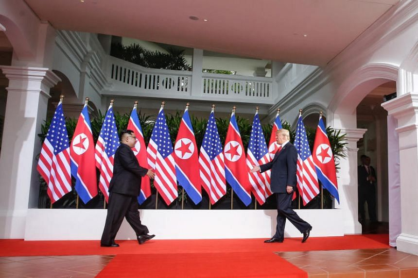 US President Donald Trump and North Korean leader Kim Jong Un greeting each other during their meeting on June 12, 2018.