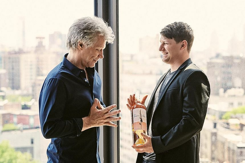 Jon Bon Jovi and his son Jesse Bongiovi with their French rose, made with the help of winemaker Gerard Bertrand.