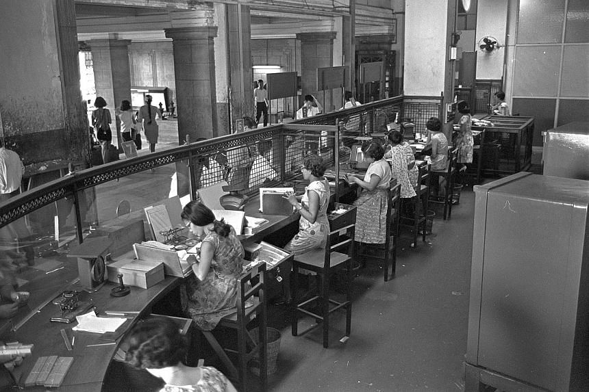 Counters at the former General Post Office in the Fullerton Building and two stamp safes (right).