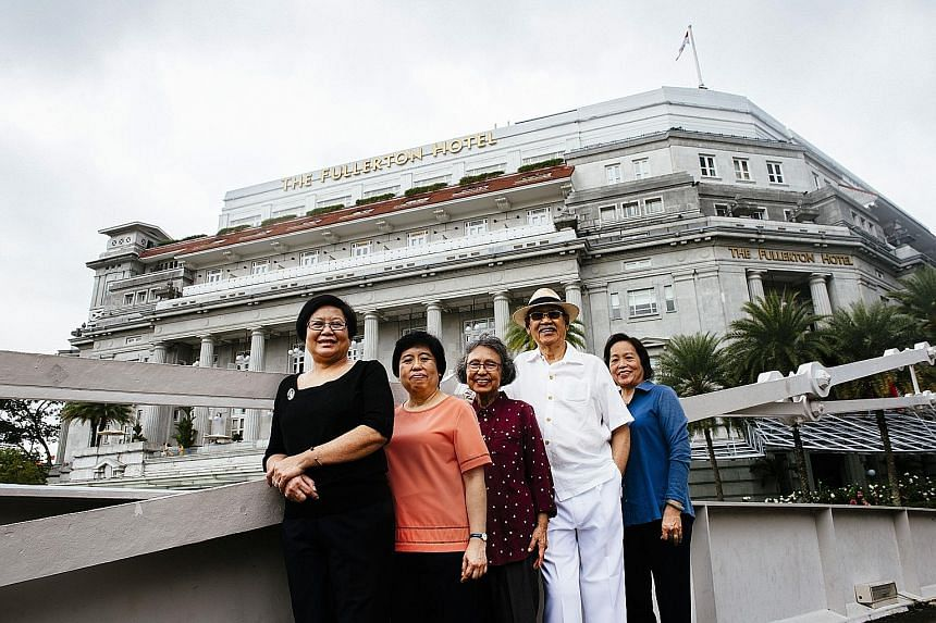 (From left) Ms Sandra Liew, Ms Judy Tam, Madam Tan Lat Neo and her husband Robert Lim, and Ms Cynthia Low , all of whom worked at the former General Post Office in the Fullerton Building, which is now The Fullerton Hotel Singapore. The hotel is colle