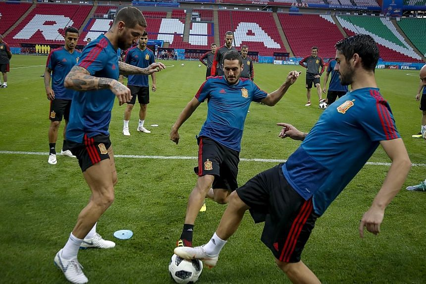 From left: Spain captain Sergio Ramos and midfielders Koke and Isco having a kickabout during training ahead of today's Group B decider against Morocco. La Roja are level with Portugal on four points, with Iran one behind.